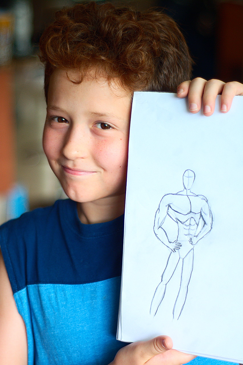 Javier jumped on youtube and looked up a super hero drawing educational video and went to town. He's proud of his character. Now he just needs a super power.