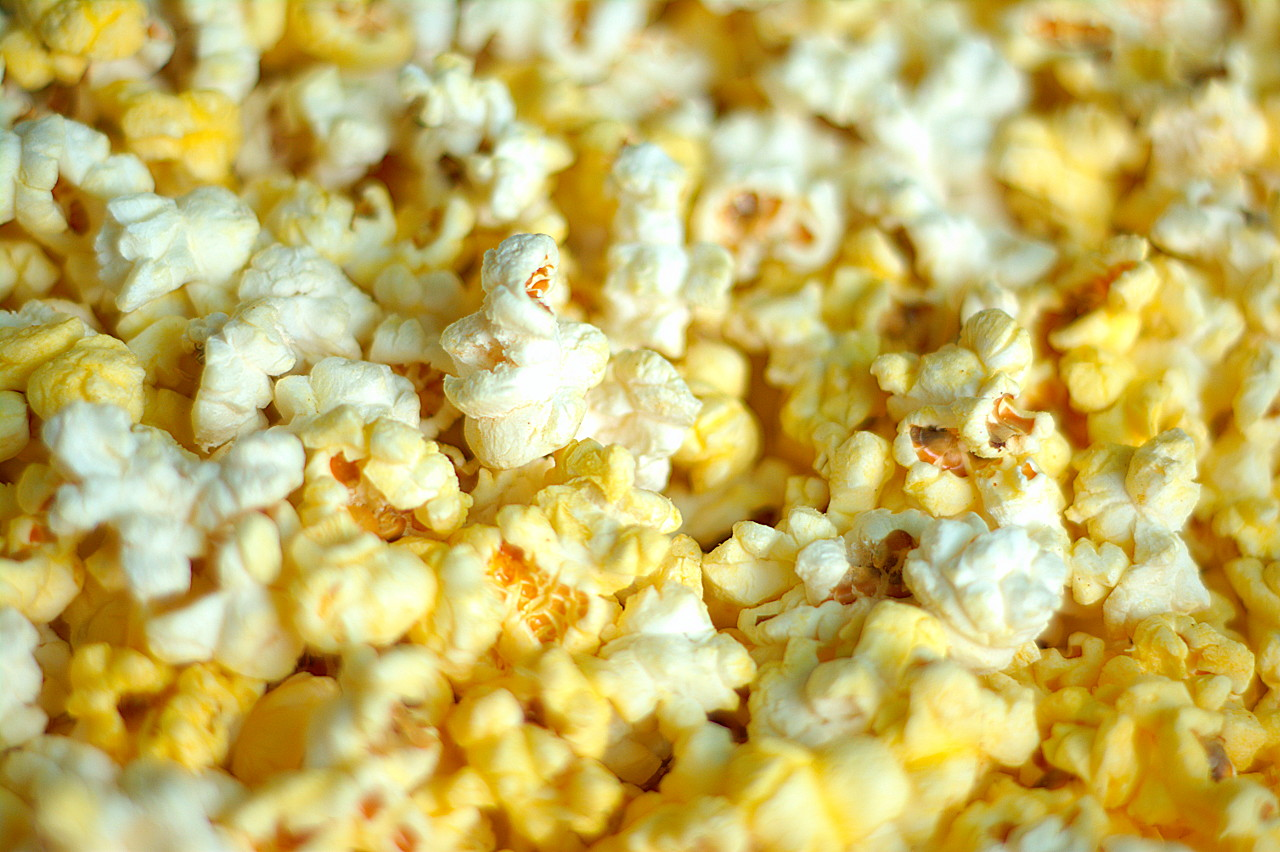 Popcorn made fresh with achiote infused canola oil (for that nice yellow color), dusted with powdered sugar and Lawry's seasoned salt. Yummy
