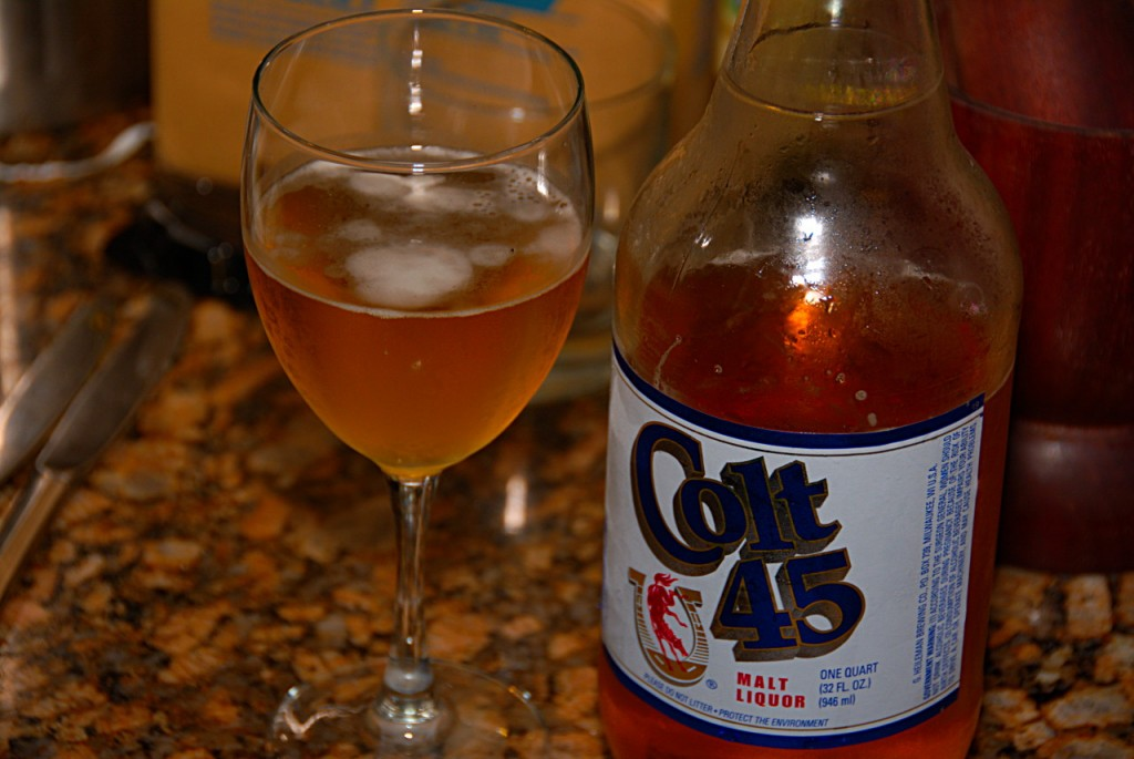 "Always nice to kick back with the wife and a 40. Class it up with a wine glass. ""Colt 45, it works every time."""